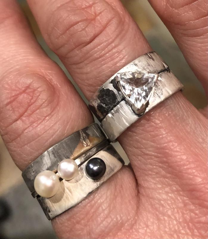 Industrial oxidised Sterling silver stacking rings with white and dark pearl and Topaz