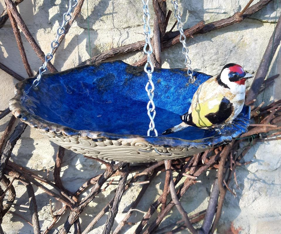 life-size goldfinch, blue birdbath with coils&dots