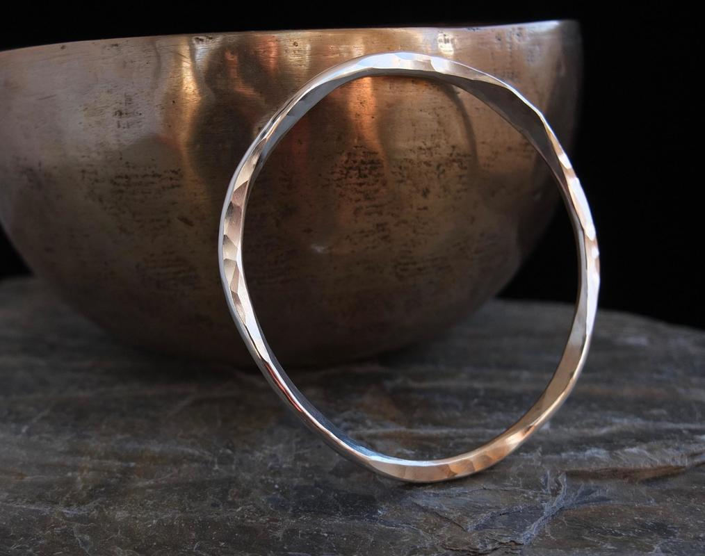 Hammered silver 'wonky' bangle £55