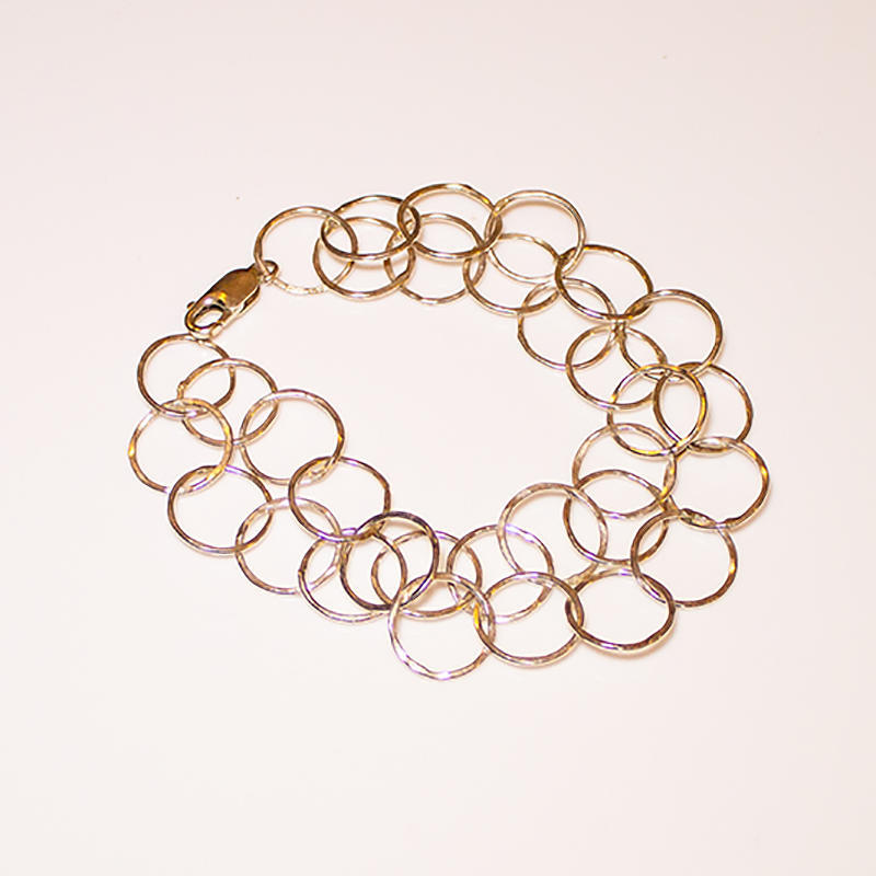 Sterling silver bracelet with round hammered rings, £65