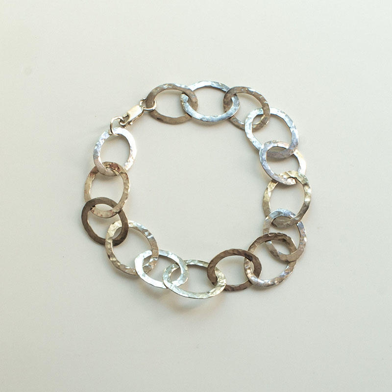 Sterling silver bracelet with oval hammered rings, £60