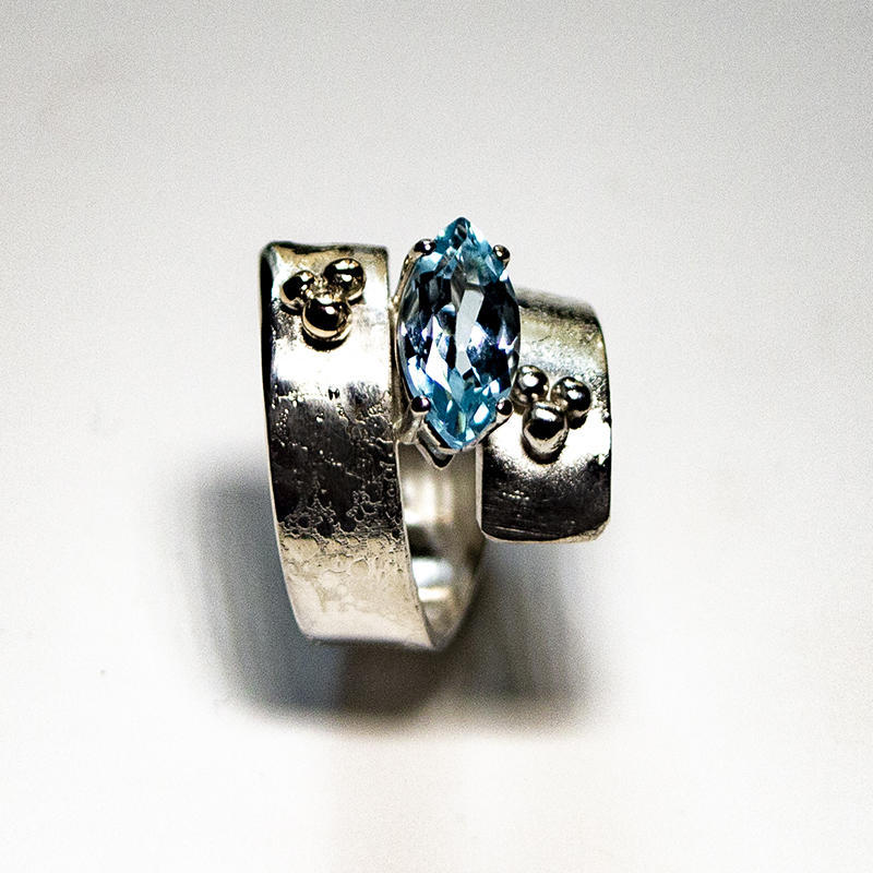 """Sterling silver """"dotty"""" ring with ogive blue topaz, size M, £120"""