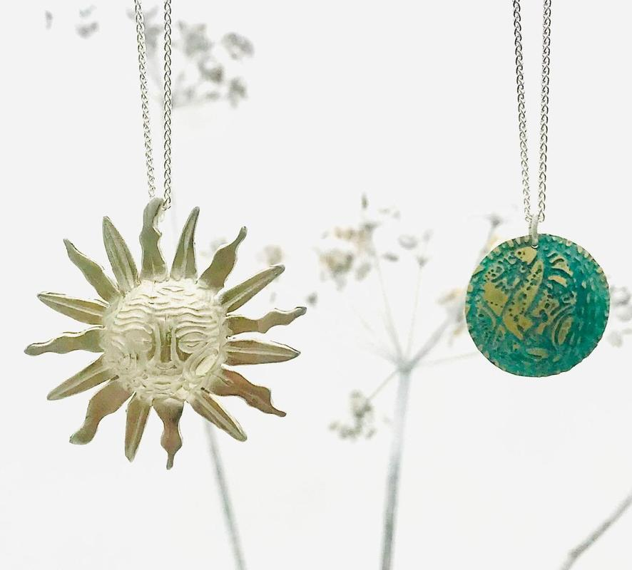 'Sun & Moon' pendants- silver sun & a photo-etched brass moon with a green patina.