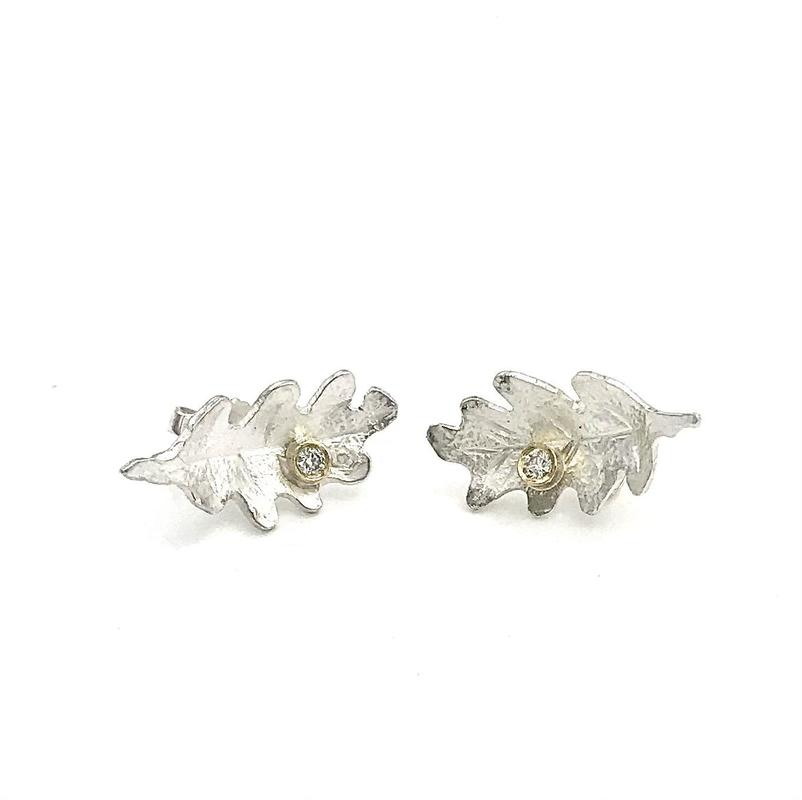 'Hazel' stud earrings- hand embossed silver oak leaves with 2mm round diamond set in 18ct yellow gold.