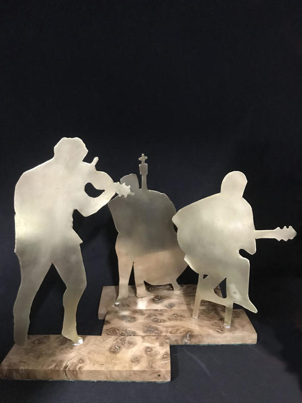 Three musicians - brass on wooden base