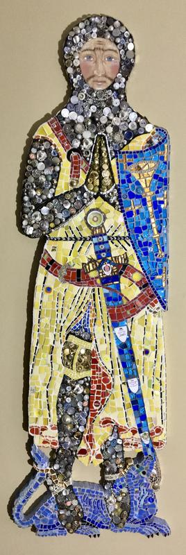 Roger de Trumpington.  The armour of this crusader knight is recreated in silver and gold buttons and coins.  His face is drawn with pastels  to give him a warmth and energy. 115 x 36 x 2cm
