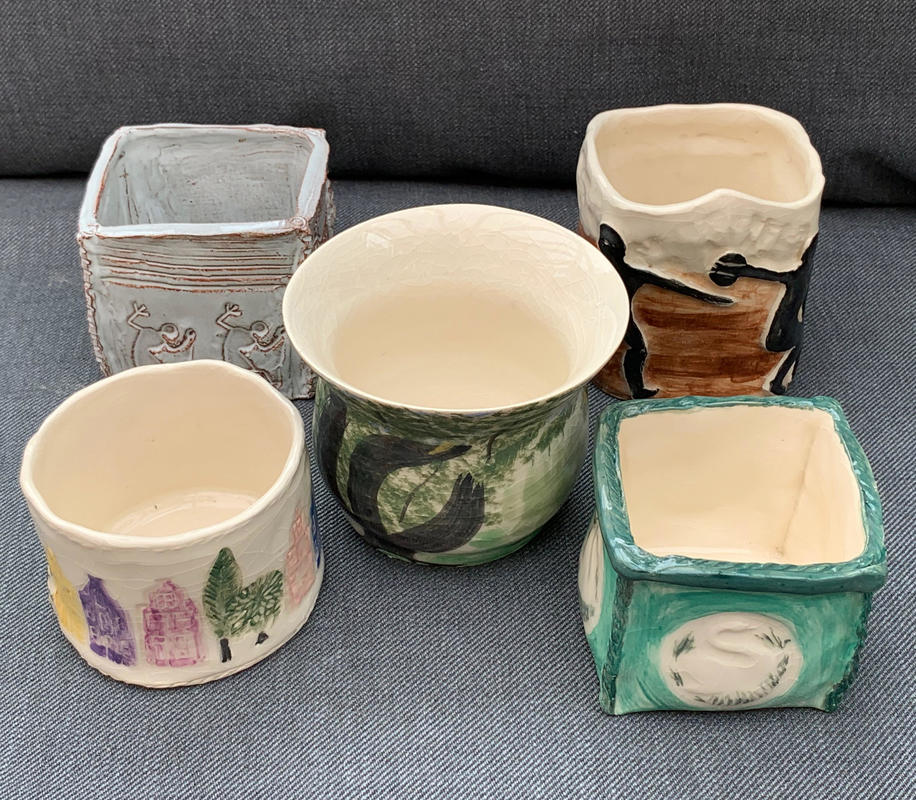 Five small uniquely decorated pots