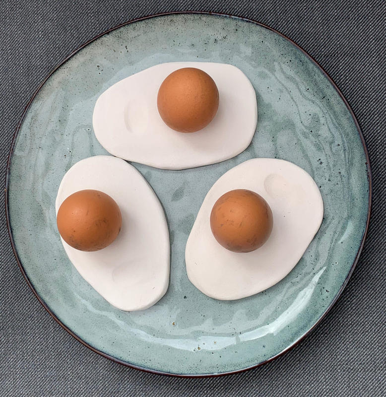 Three eggcups on blue plate