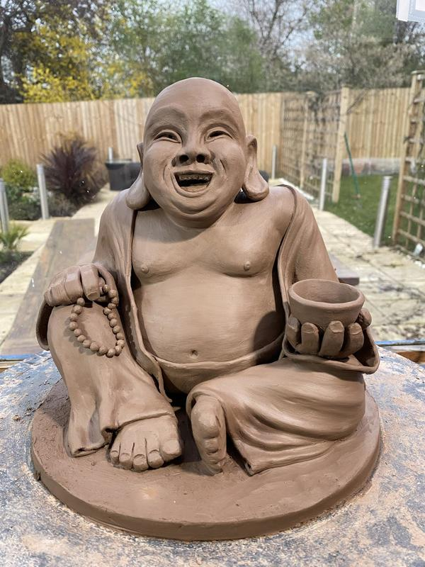 A laughing Buddha - just completed and drying for the kiln