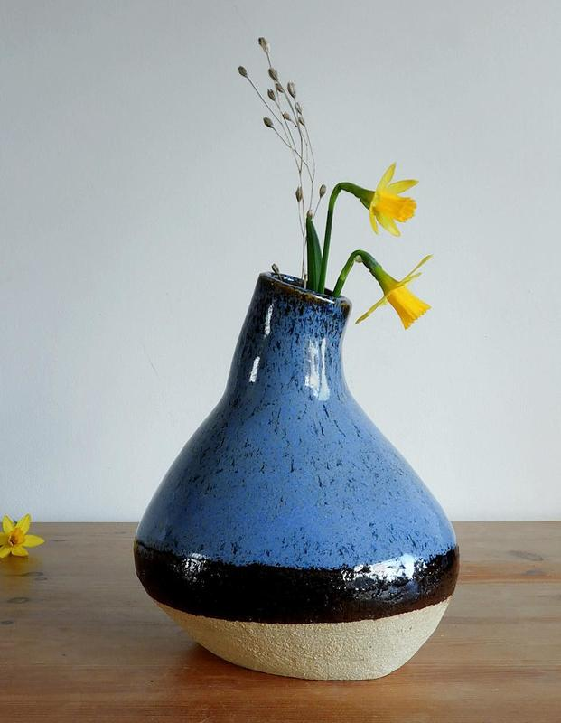 Blue and Clay bottle, Hand built ceramic vase/bottle.  Part glazed in dark blue on the outside, glazed internally. Stoneware.