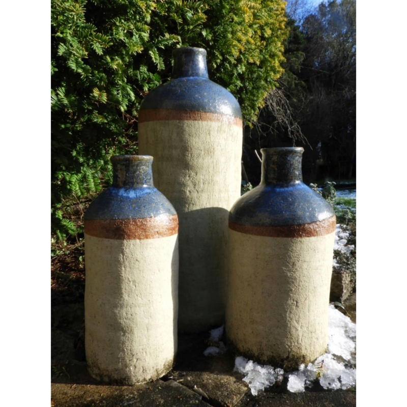 Three Large Bottles. Decorative bottles for the garden! Inspired by old Dutch Jenever bottles. Partially glazed in blue chun glaze.