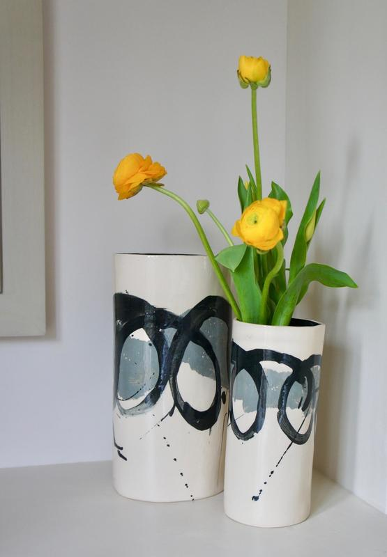 Earthenware vases with grey and black slip decoration