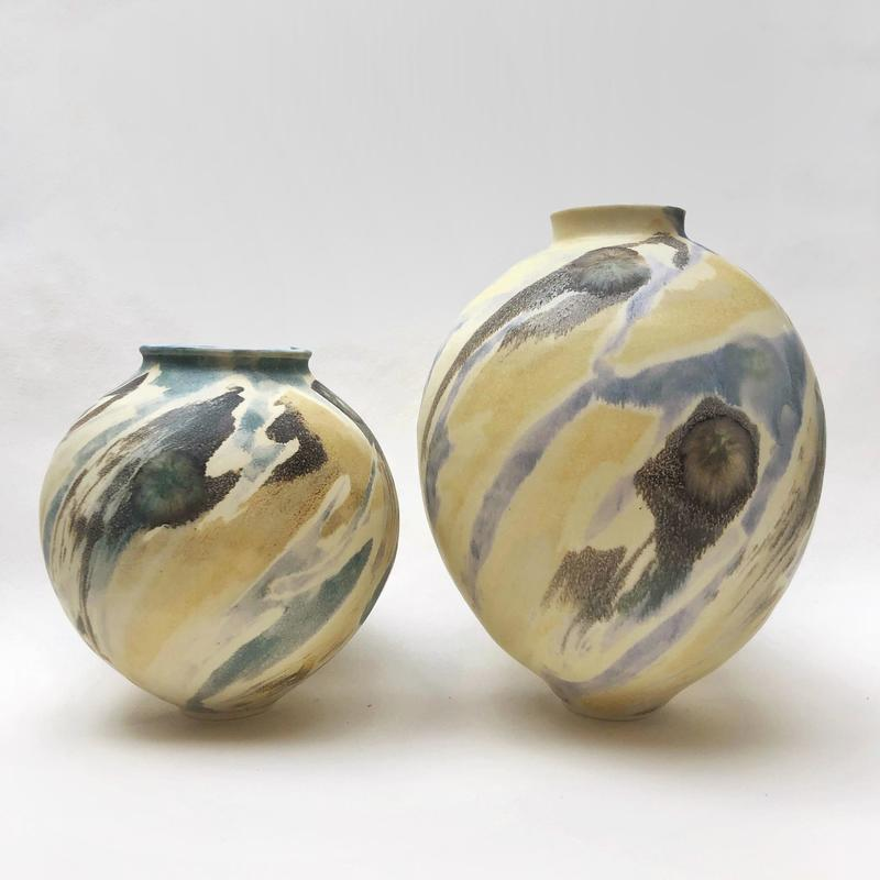 two small porcelain pots with layered abstract glazes, smaller is £50, larger £65, prices include postage