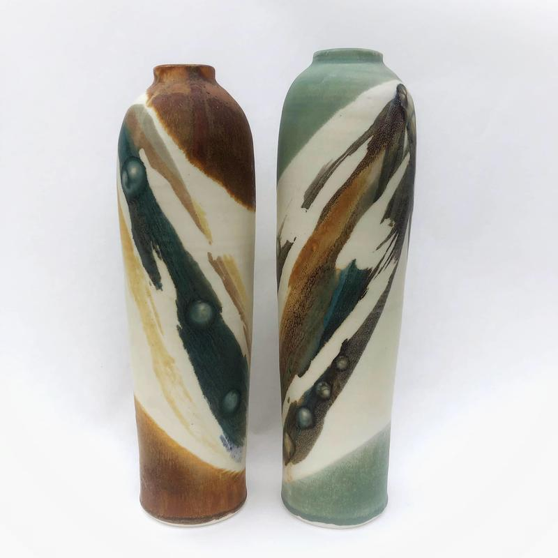 tall pots with abstract decoration with ash glazes
