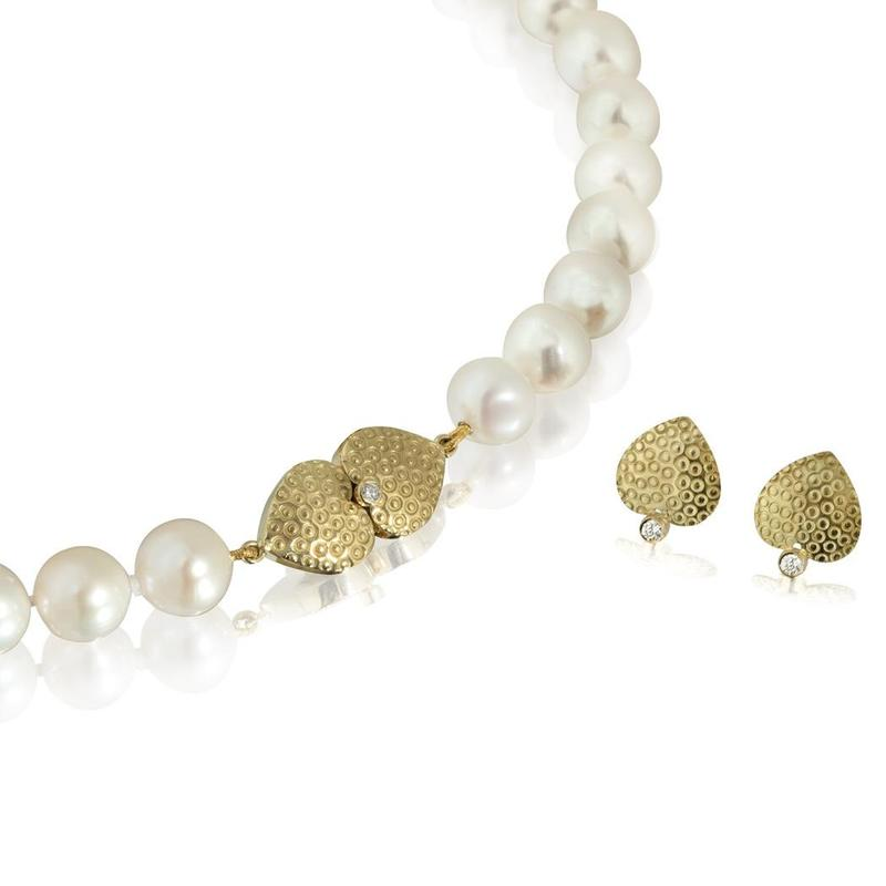 Pearl necklace with an 18ct gold & diamond clasp with matching earrings.