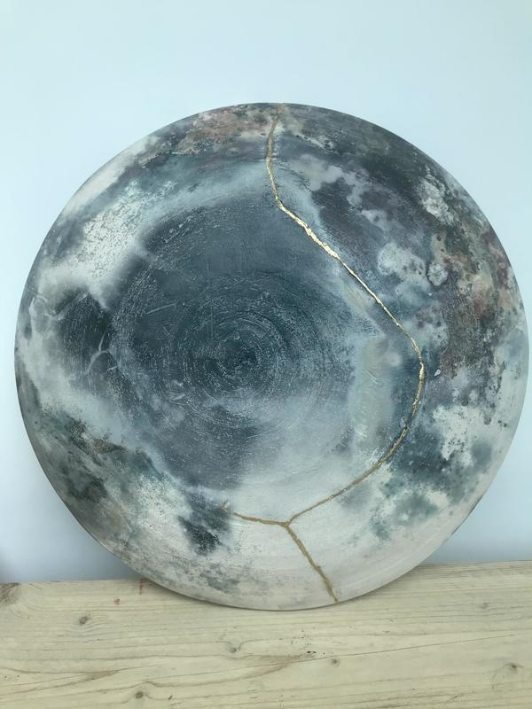Pit fired wall hanging platter, approx 37cm diameter, broken & joined with gold detail £280