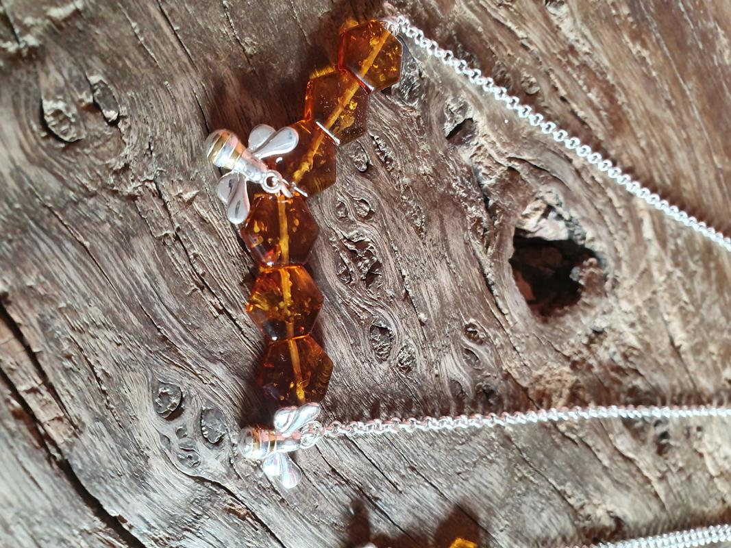 Amber with sterling silver bees and chain.