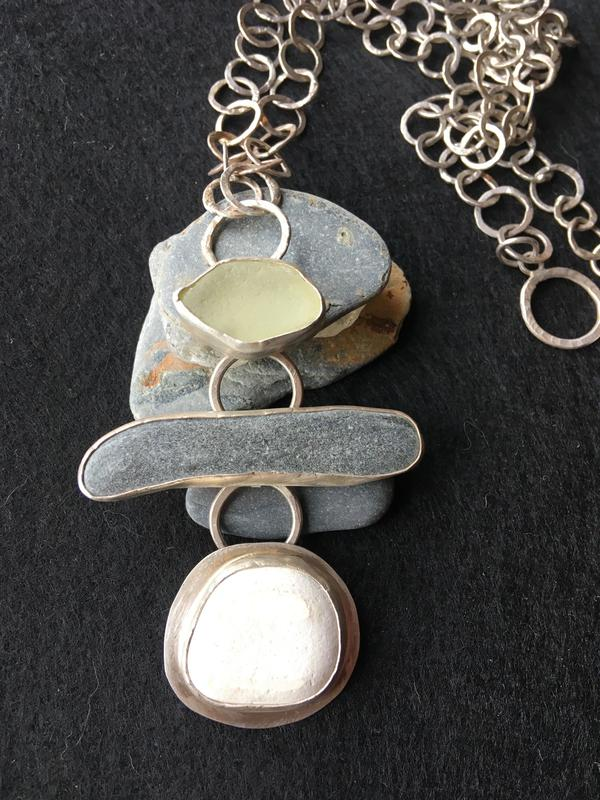 Sea-glass and beach-pebble pendant on handmade sterling silver chain. £135.