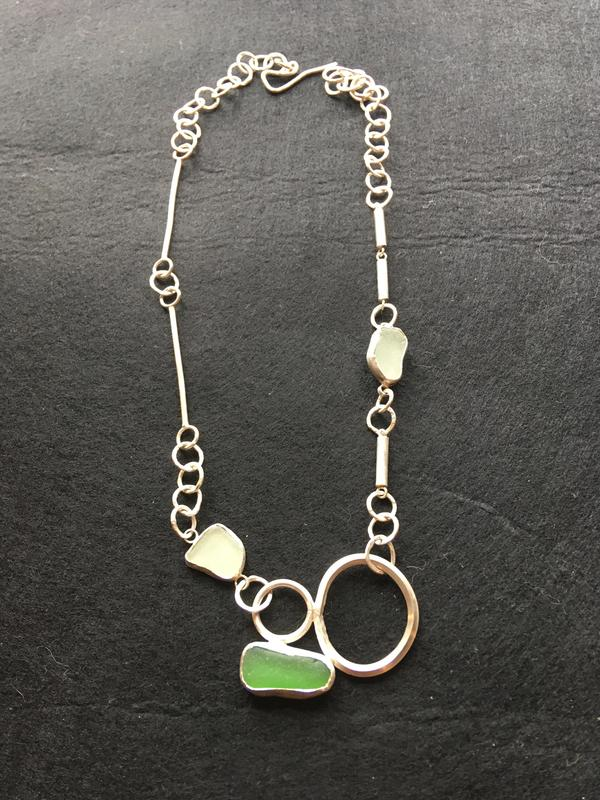 Sterling silver necklace with green and white sea-glass. £150.