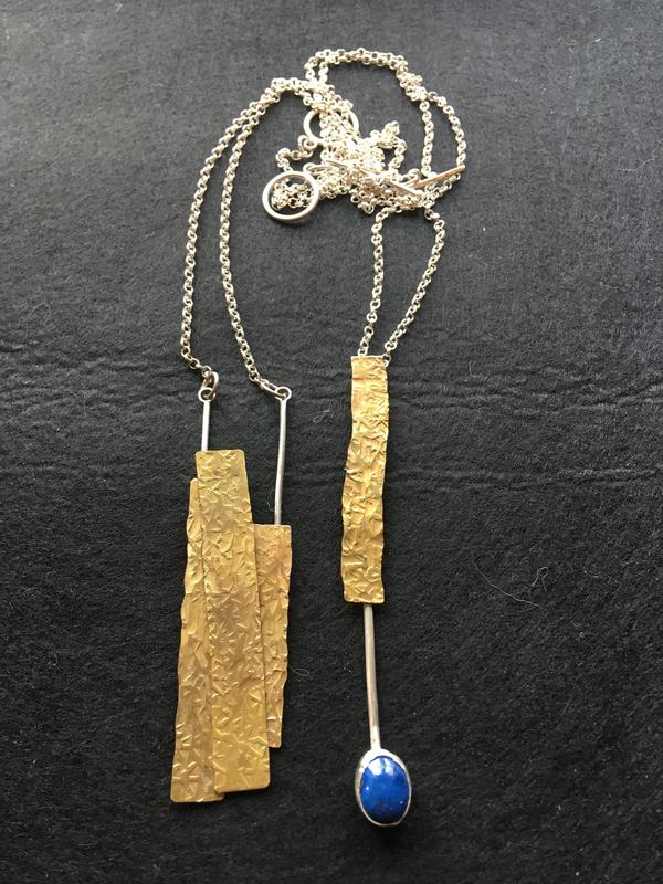 Hammered brass and sterling silver pendants on sterling silver chain. £55 each.