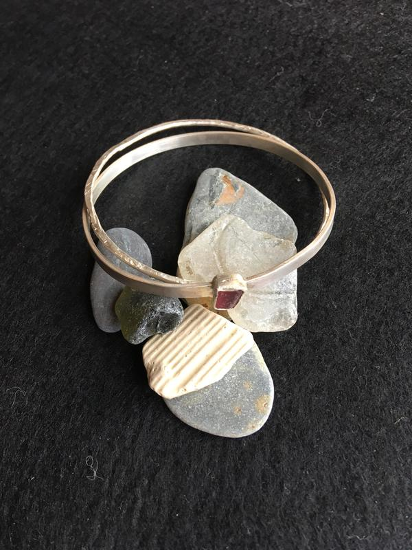 Sterling silver bangle with pink sea-glass. £55.