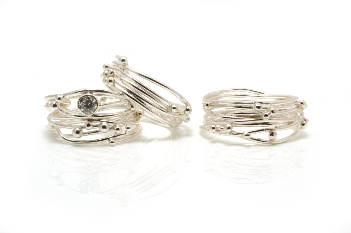 Rings silver with silver beads and some with faceted stones