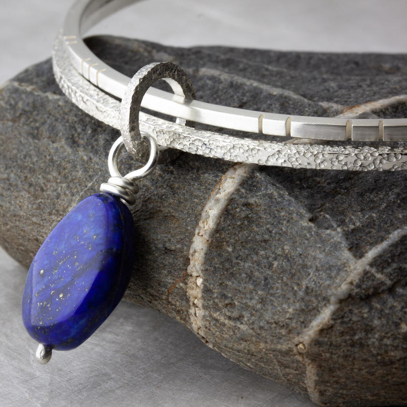 Textured sterling-silver bangle set with lapis lazuli dangle 66mm diameter £105