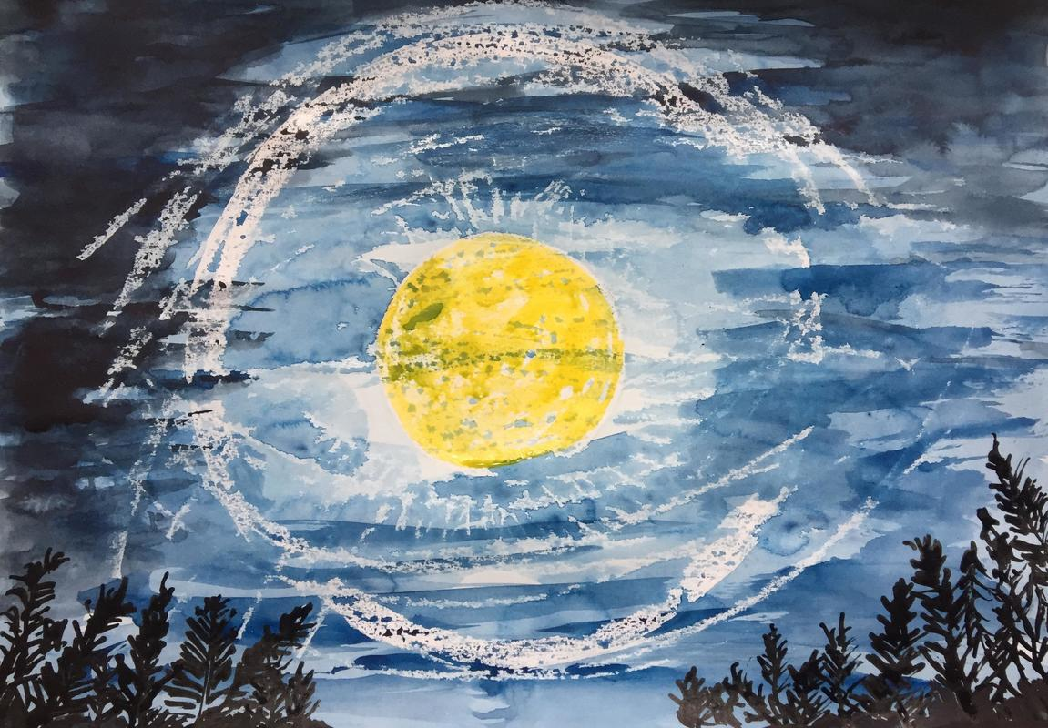 Perfect circle round/the moon/In the centre of the sky