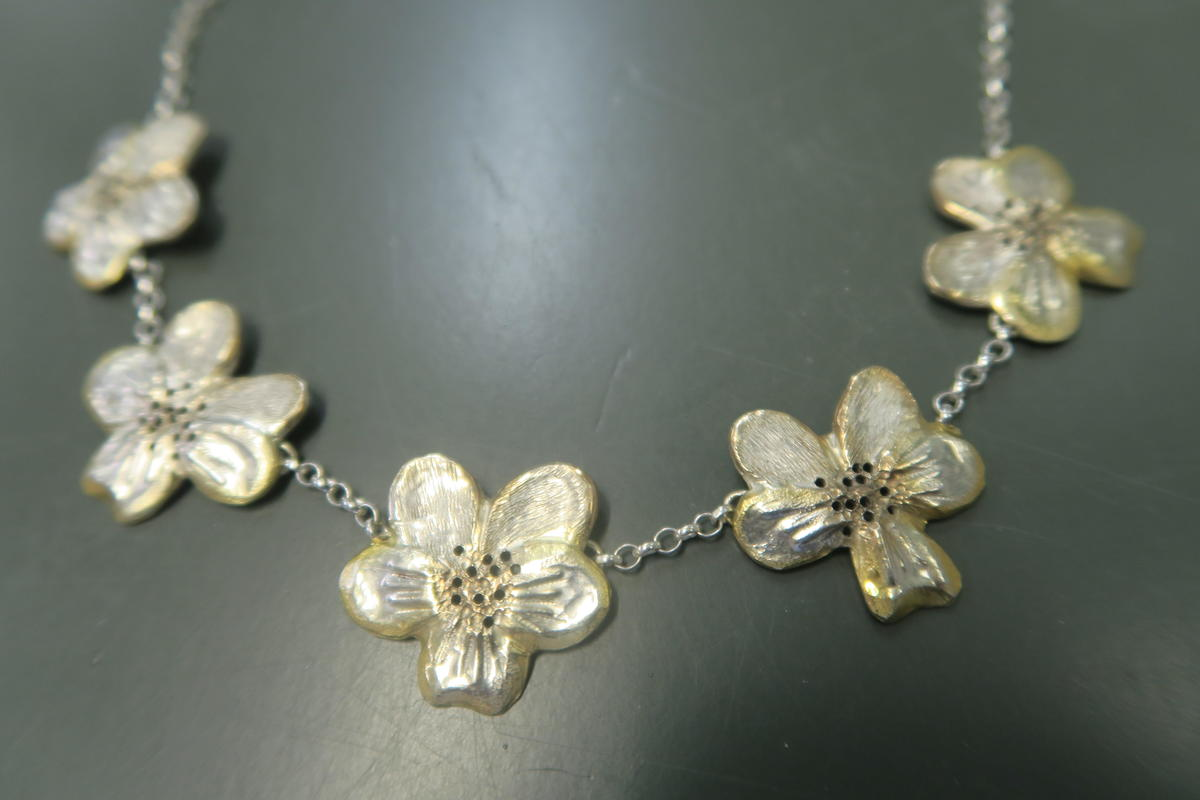 12.	Not for sale. Viola inspired necklace using chasing and repousse with gilding