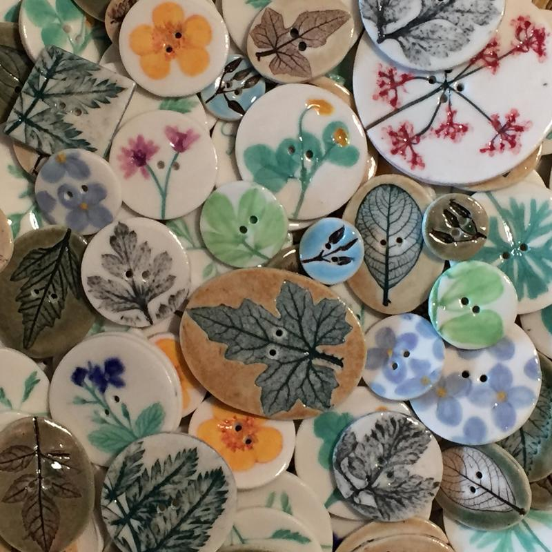 Botanical buttons, decorated using imprints of plant material.