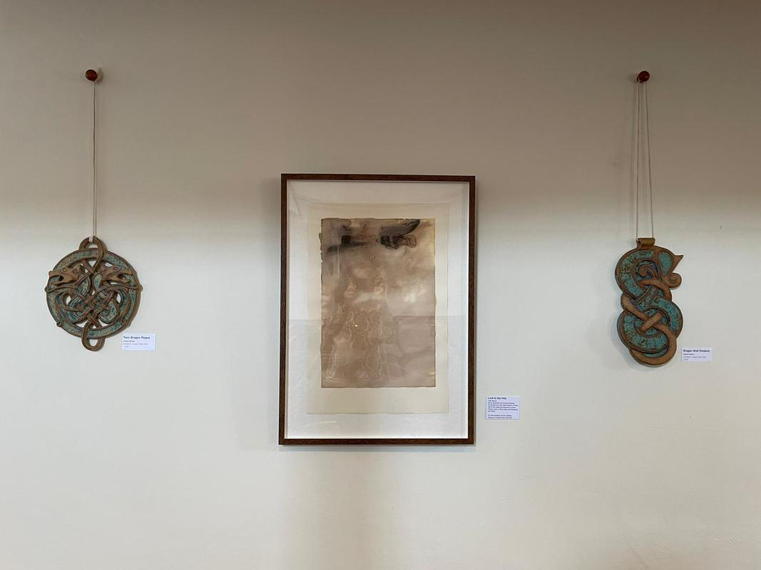 Look to the Hills on display at ArtWeeks 2021 nestled in between two Viking inspired wall sculpture pieces by Andrea Brewer