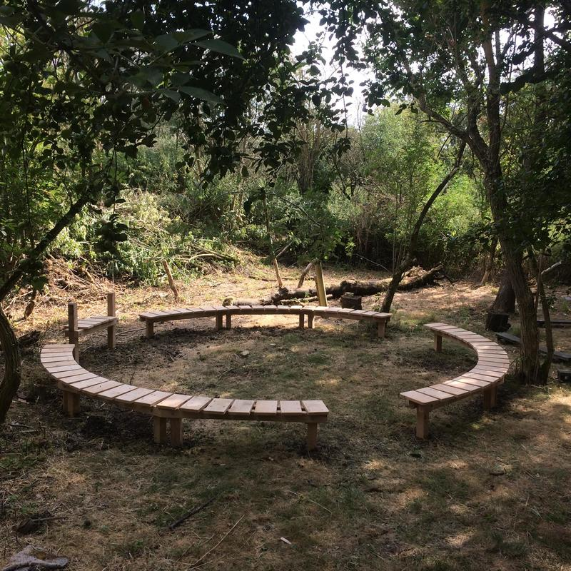 An outdoor teaching space with circular seating.