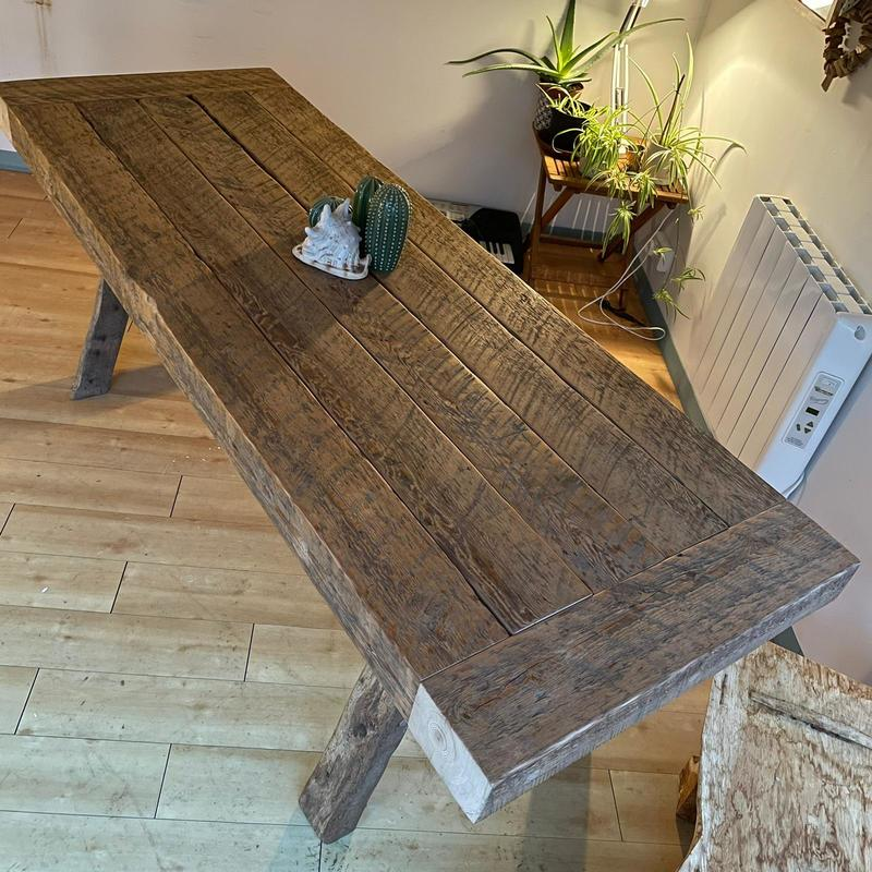 Reclaimed roof purlin dining table