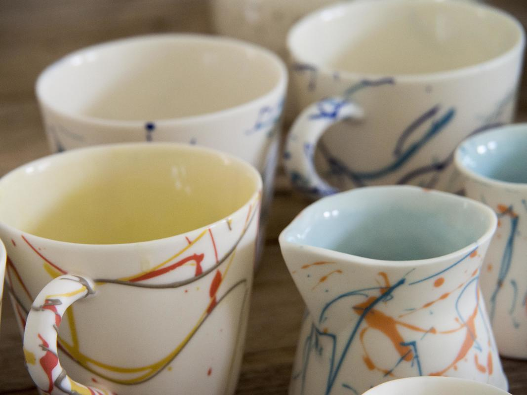 Selection of parian porcelain mug, jug and vases in bird plumage colour schemes