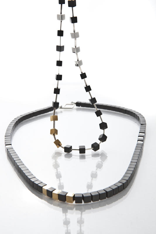 haematite, silver and 18ct gold-plated cube necklace £195
