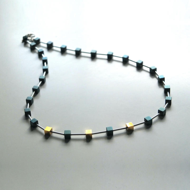 teal haematite, silver and 18ct gold-plated cube necklace £195