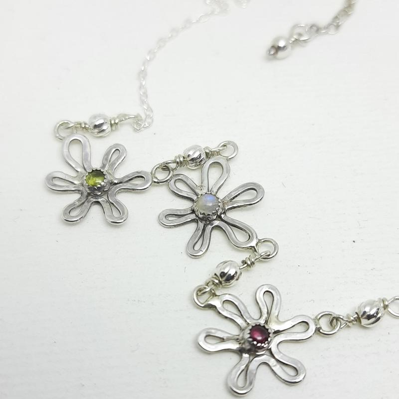 Silver flowers set with Peridot, Moonstone & Garnet Cabochons