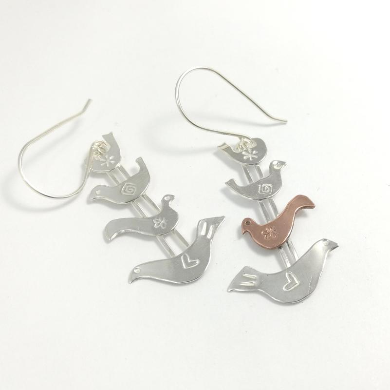 Silver Bird Earrings with an odd-one-out copper bird!