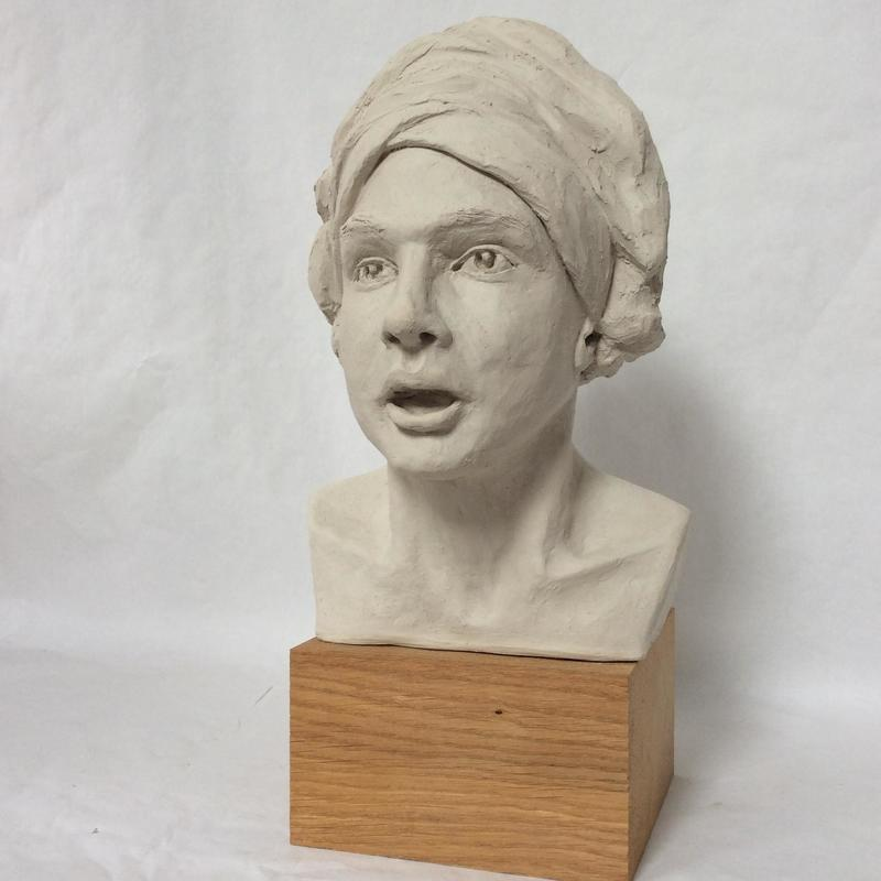 Singing man - clay as yet unfired
