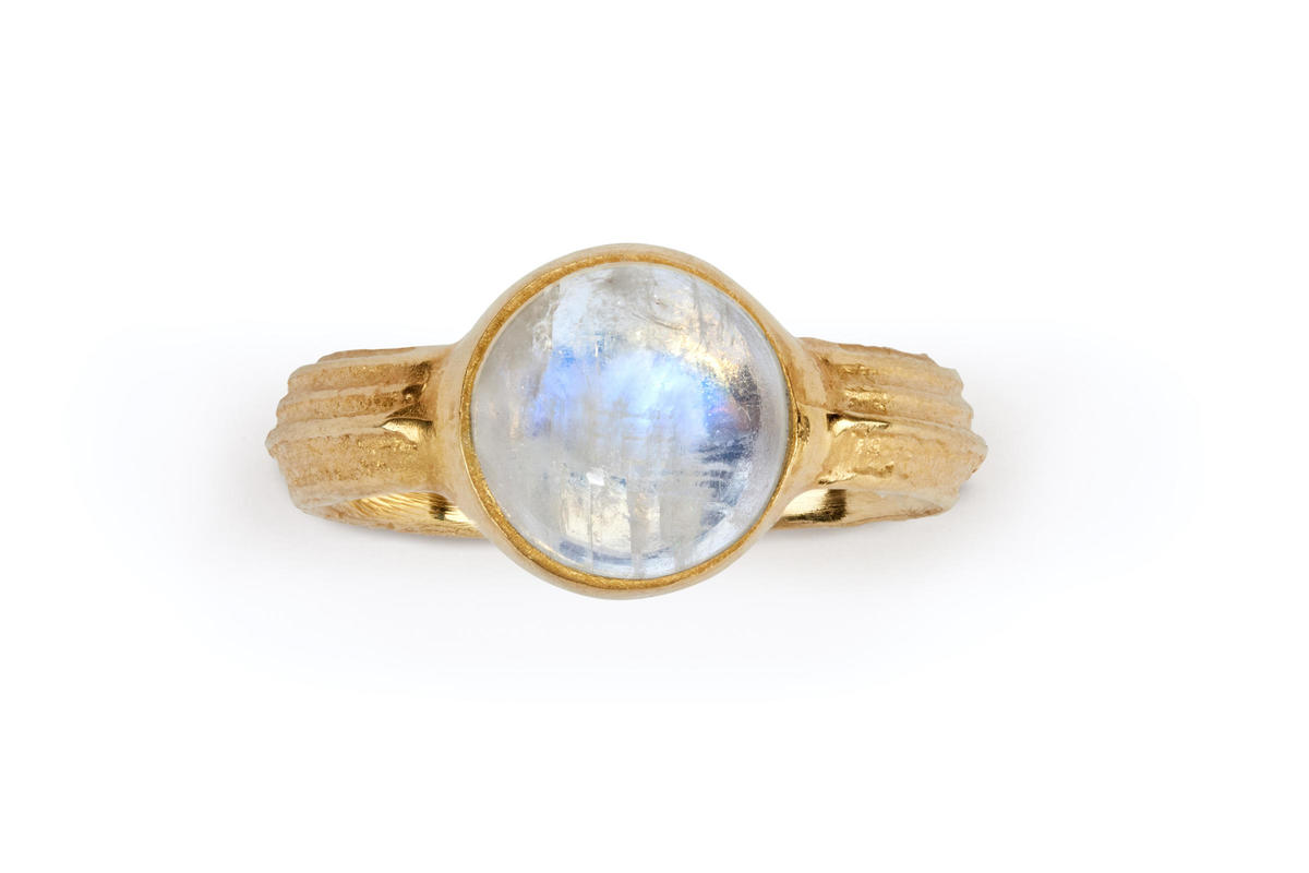 Rainbow moonstone set in a 18ct gold cow parsley textured band £2300