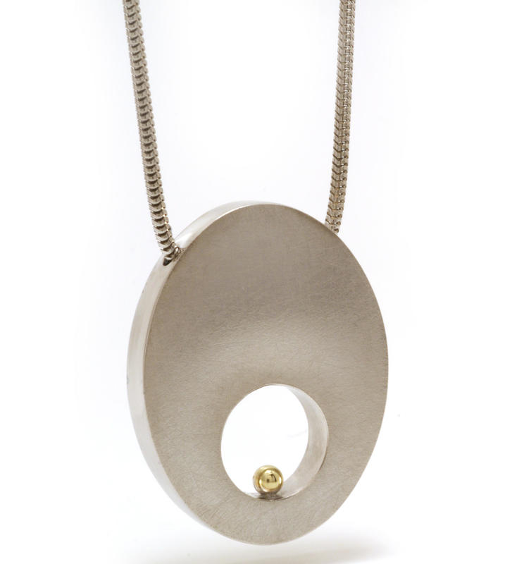 Machi de Waard oval pendant with hole and gold detail