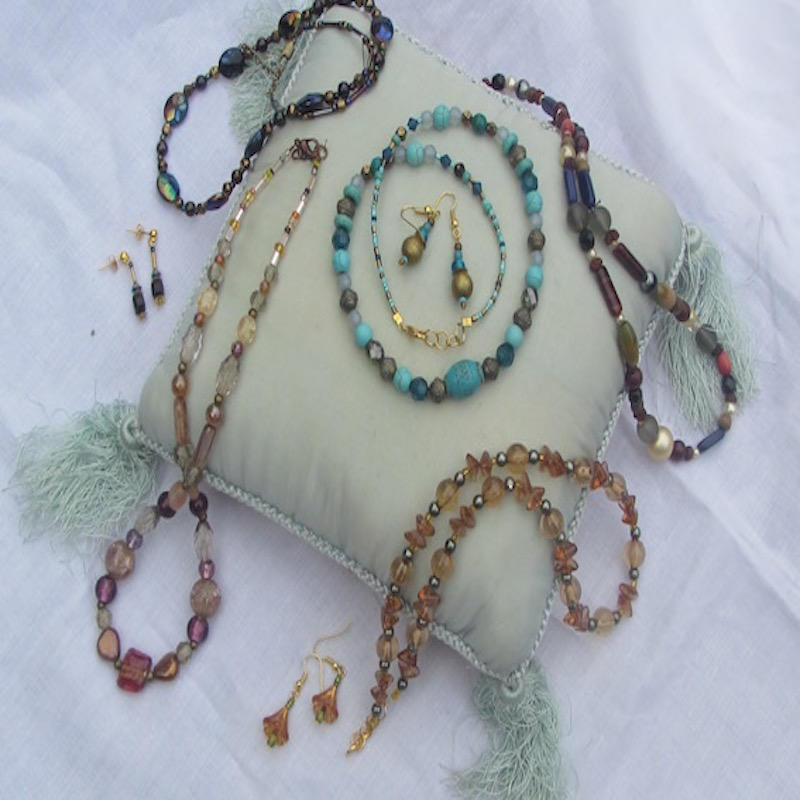 A selection of jewellery made from recycled beads.