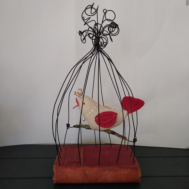 bird cage on a book
