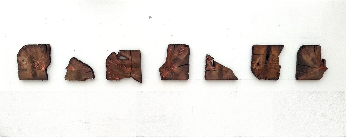 """""""Acts of Preservation"""", railway sleeper fragments bound with copper thread. (2020)"""