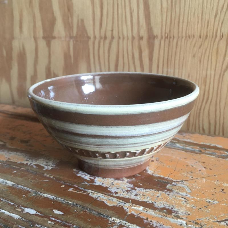 Small, terracotta slip decorated and incised bowl in white, yellow and green colours
