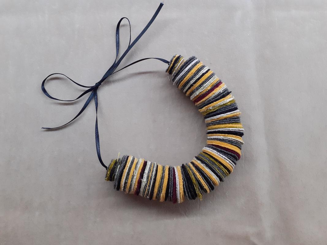 fabric coil necklace grey and yellow tones