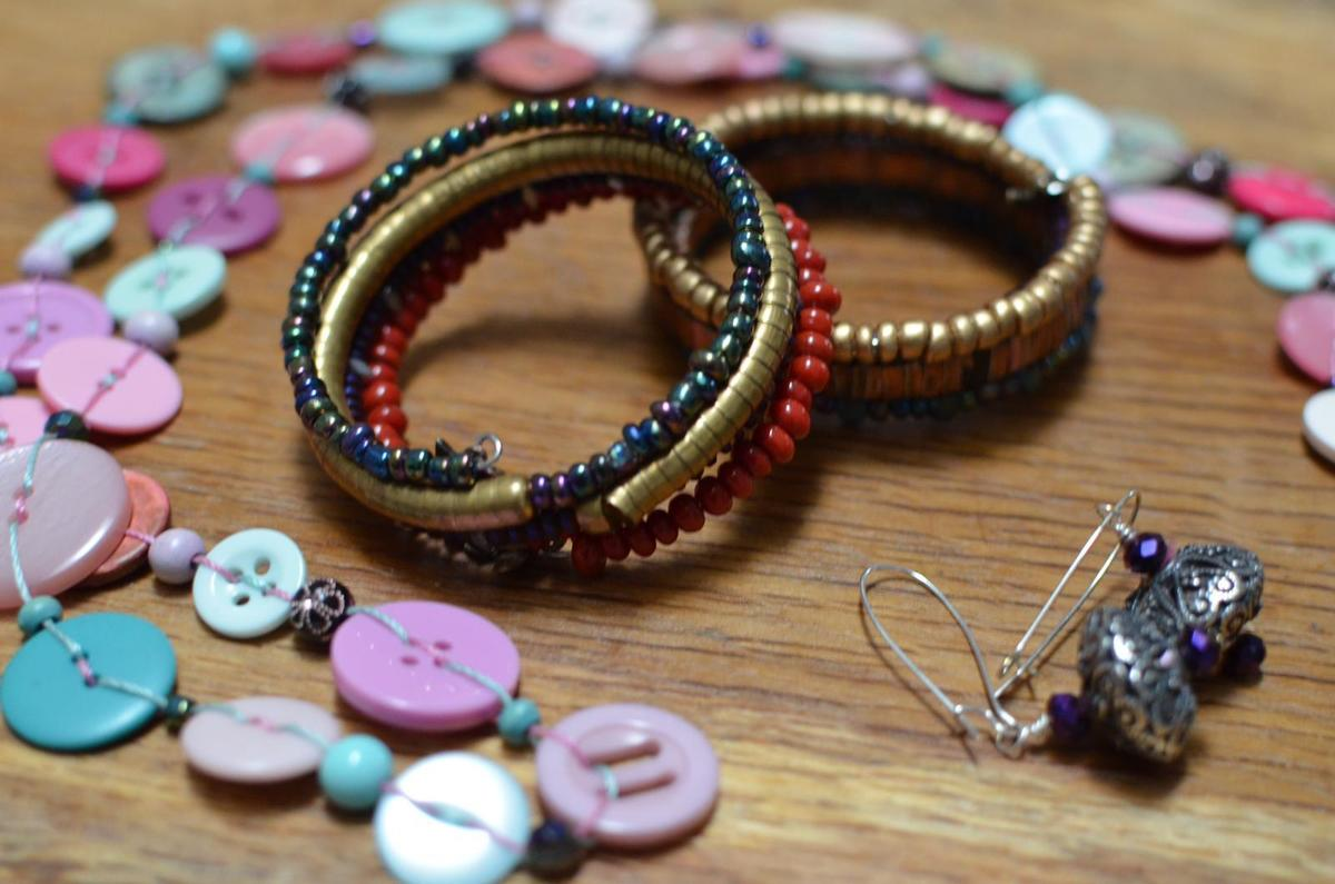 button necklace , coil bracelets and metal earrings