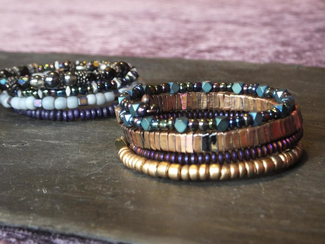 blue and gold /silver tones coil bracelets