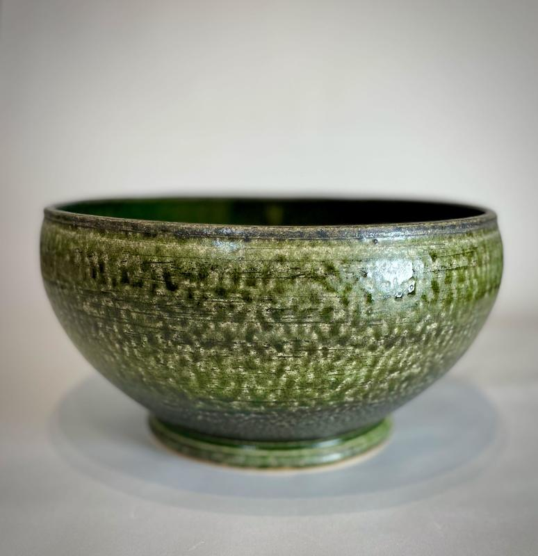 Wheel thrown super bowl. Finished in mixed ash glaze.