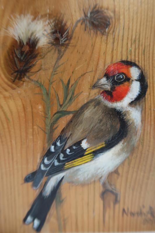 Goldfinch painted on wood.